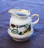 Beautiful porcelain milk pot Royalty Free Stock Images