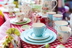 Beautiful porcelain tea set on table. With square pattern cloth in vintage style in kitchen stock photo