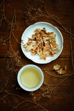 Beautiful porcelain white chinese cup of herbal tea and saucer w Royalty Free Stock Photography