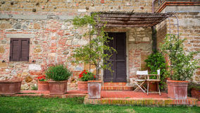 Beautiful porch in front of an old house in Tuscany Stock Photos