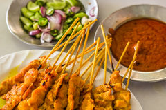 Beautiful pork satays with side dishes ready to eat thai style Stock Images