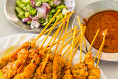Beautiful pork satays with side dishes ready to eat thai style Stock Image