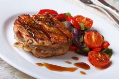 Beautiful pork steak with vegetables close-up, horizontal Royalty Free Stock Photo