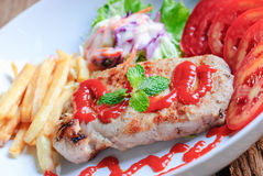 Beautiful pork steak with vegetables Royalty Free Stock Photos