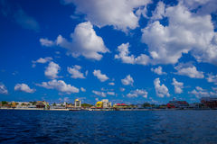 Beautiful port of Cozumel with some boats and buildings behind Stock Images