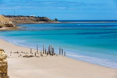 The beautiful Port Willunga beach and iconic jetty ruins with turquoise waters on a calm sunny day on 15th November 2018. The beautiful Port Willunga beach and stock images