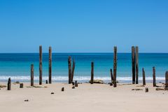 The beautiful Port Willunga beach and iconic jetty ruins with turquoise waters on a calm sunny day on 15th November 2018. The beautiful Port Willunga beach and stock image
