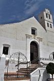 Beautiful portal of San Antonio church with art iron bars and steps  in Frigiliana - Spanish white village Andalusia. Beautiful and charming with its narrow Royalty Free Stock Photo