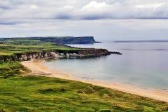 Beautiful Portbraddan between the cliffs of Whitepark Bay, Antrim Coast. Beautiful Portbradden set like a jewel between the cliffs of Whitepark Bay, Antrim Coast royalty free stock image