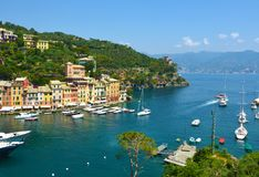 The beautiful Portofino with colorful houses and villas, luxury yachts and boats in little bay harbor. Liguria, Italy, Europe. Royalty Free Stock Photos