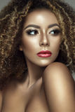 Beautiful portrait of afro woman. Young lady posing close up with colorful make up and curly hair Royalty Free Stock Photo