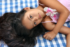 Beautiful portrait of Asian little girl. Little Asian beautiful girl in South cruise style lying at the cloth stock photos