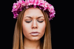 Beautiful portrait of a blonde girl with a pink crown of flowers Royalty Free Stock Images