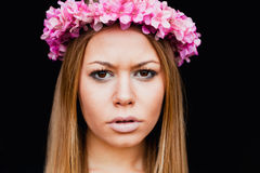 Beautiful portrait of a blonde girl with a pink crown of flowers Stock Photo