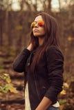 Beautiful portrait of brunette woman wearing sunglasses Stock Image