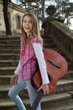 Beautiful Portrait of a Carefree Friendly Smiling Girl with Guitar Stock Images