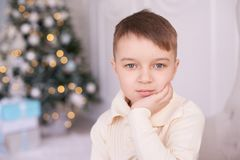 Beautiful portrait. Christmas interior. Little boy. Horizontally. Light hair. White background Royalty Free Stock Photos