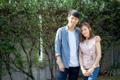 Beautiful portrait couple looking each others eyes and smiling with happy, young asian man and woman relation with love dating royalty free stock photos