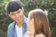 Beautiful portrait couple looking each others eyes and smiling with happy, young asian man and woman relation with love dating royalty free stock photography