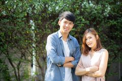 Beautiful portrait couple looking each others eyes and smiling with happy, young asian man and woman relation with love dating stock photos