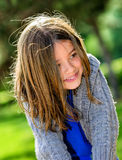 Beautiful portrait of cute child playing. With greenery in the background Royalty Free Stock Photography