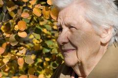 Beautiful portrait of an elder woman outdoors Stock Photo