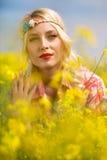 Beautiful portrait in flowers Stock Image