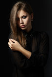 Beautiful portrait of girl. Black background Royalty Free Stock Photo