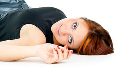 Beautiful portrait of a girl lying isolated Stock Images