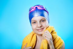 Beautiful portrait of a girl sportswoman swimmer in swimming cap and diving goggles. royalty free stock photo