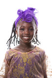 Beautiful portrait of a happy little girl smiling.Isolated. Beautiful portrait of a happy African little girl smiling in purple costume on white background stock photos