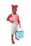 Beautiful portrait of a happy little girl with tote bag.Isolated. Beautiful portrait of a happy African  little girl smiling  with wicker blue tote bag in Royalty Free Stock Photos