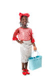 Beautiful portrait of a happy little girl with tote bag.Isolated. Beautiful portrait of a happy African  little girl smiling  with wicker blue tote bag in Royalty Free Stock Photo