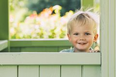 Beautiful portrait of a laughing child boy outdoors. Stock Images