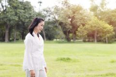 Beautiful portrait of lovely middle aged woman smiling and relax royalty free stock photo