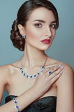 Beautiful portrait of model with jewelry. Brunette girl. Perfect makeup. royalty free stock photography