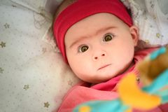 Free Beautiful Portrait Of 5 Week Old Baby Girl Lying In A Crib Looking Up Towards Camera. Baby Care Concept Stock Photo - 165398770