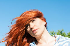 Beautiful portrait of redhead girl standing outside Stock Images