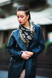 Beautiful portrait of rock woman model in leather jacket with da Royalty Free Stock Photos