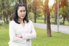 Beautiful portrait of senior woman thinking and relaxing at the park. stock image