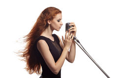 Beautiful portrait of singing girl with retro Stock Photo