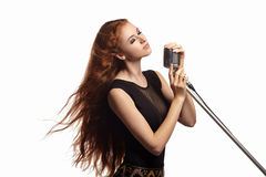 Beautiful portrait of singing girl with retro Royalty Free Stock Photo