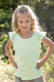 Beautiful Portrait of smiling little girl outdoors Stock Photos