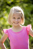 Beautiful Portrait of smiling little girl outdoors Stock Photography