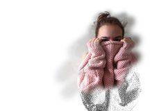 Teenage girl in pink knitted sweater. Beautiful portrait of thirteen year old girl hiding her face in warm pink knitted loose sweater. Drawing and brushed In royalty free stock photo