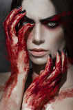 Beautiful portrait of woman with bloody hands stock images