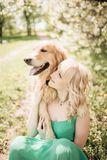Beautiful portrait woman with a cute golden retriever dog sitting stock photos