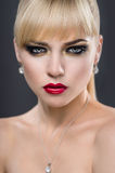 Beautiful portrait of a woman with fashion makeup Stock Photo