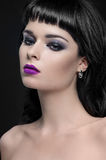 Beautiful portrait of a woman with fashion makeup Stock Photography