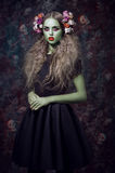 Beautiful portrait of woman with green skin Stock Image